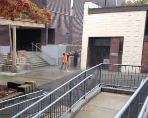 Technicians Pressure Washing Campus Grounds